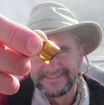 Bruce Damer holding a vial